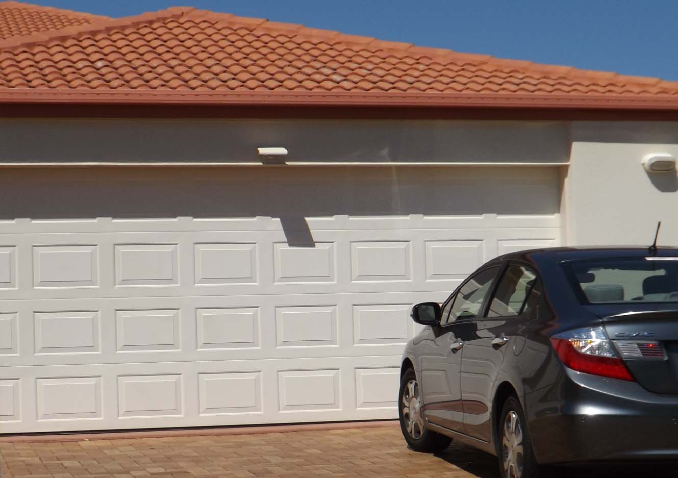 Sectional or Panel Lift Garage Doors | Brisbane Gallery